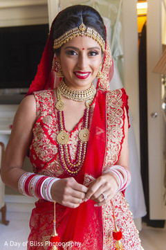 Adorable Indian bride getting ready