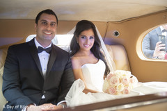 Beautiful Indian bride and groom inside their ride
