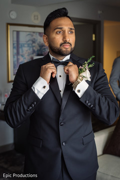 Charming Indian groom ready for Christian wedding.