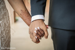 Indian  bride and groom holding hands close up capture.