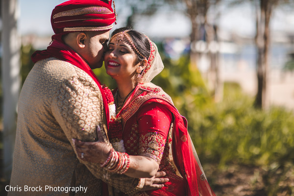 Dreamy Indian bride and groom  kiss photography.