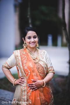 Enchanting Indian bride posing with sangeet lehenga.