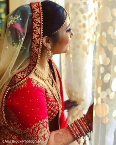 Indian bride looking out the window capture.