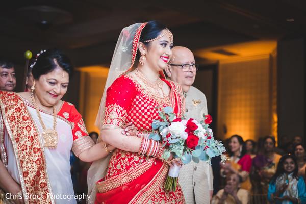 Dazzling Indian bride entrance at wedding ceremony.