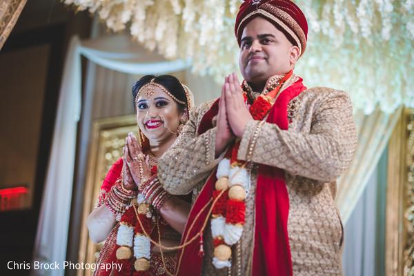 Joyful Indian couple at their ceremony rituals capture.