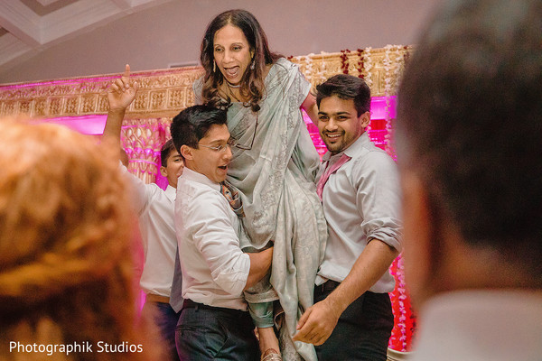 Special guests lifting the proud mother at the reception