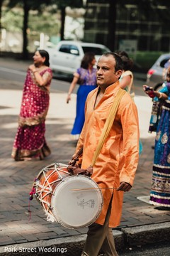 Indian baraats dhol drum player ready.