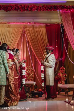 Indian bride and groom at their Jaimala Ceremony.