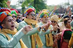 Cheerful Indian groomsmen at baraat celebration.