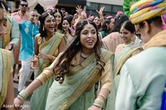 Joyful indian bridesmaids showing some dance moves.