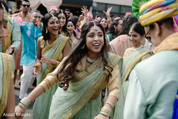 Joyful indian bridesmaids showing some dance moves.
