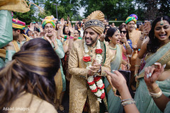 Indian groom dance at baraat procession.