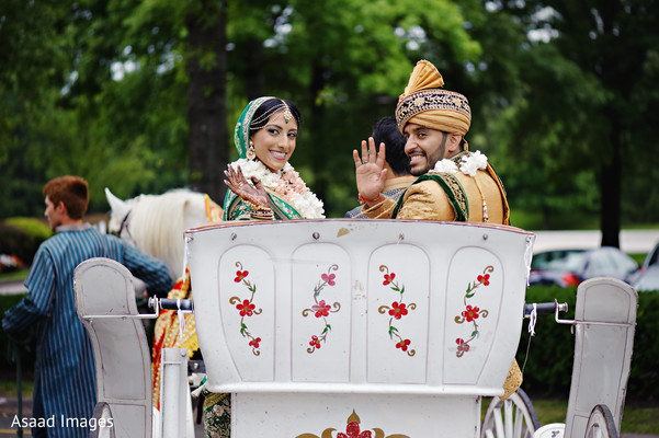 Joyful Indian bride and groom leaving from ceremony.