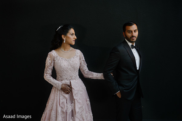 Lovely Indian couple on their reception wedding outfits.
