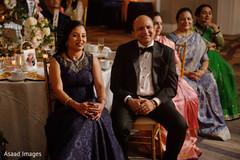 Jubilant indian wedding guests.