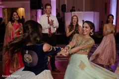 Indian wedding guests dancing the night away.