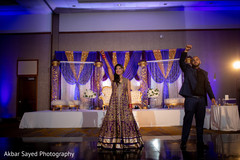 Indian bride and groom reception dance.