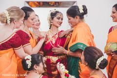 Bridesmaids assisting the Maharani