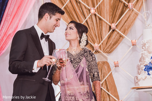 Indian bride and groom making a toast