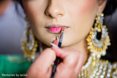 Indian bride preparing for the ceremony with makeup
