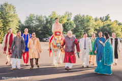 Indian groom riding the white horse for the baraat