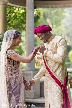 Indian groom kissing the maharani