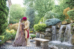 Capture of Indian bride and groom kissing by the water