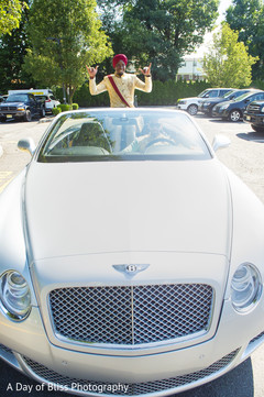 Indian groom making his entrance with the car