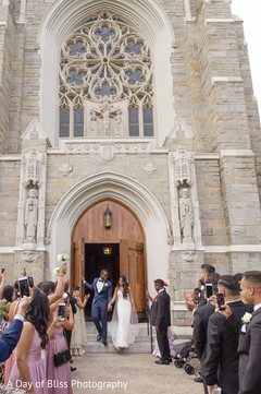 Joyful guests cheering for Indian newlyweds