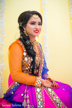 Indian bride posing for pictures before the rituals