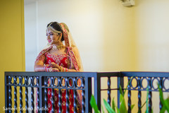 Indian bride posing for pictures at the balcony