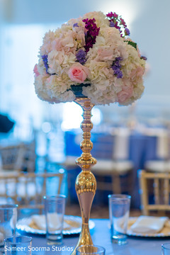 Dreamy Indian wedding reception table flower decoration.