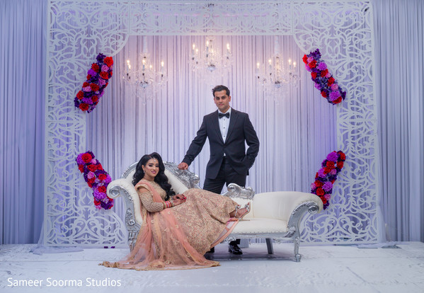 Elegant Indian couple by the stunning decor