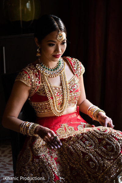 Enchanting Indian bride on her ceremony outfit.