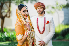 Lovely Indian bride and groom's first look capture.