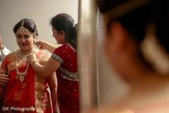 Maharani putting her Long Rani Haar.