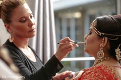 Joyful Indian bride with her makeup done capture.