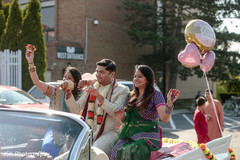 Indian groom on his baraat vehicle photo.