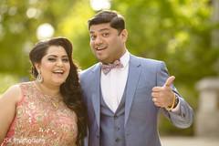 Joyful Indian bride and groom outdoors capture.