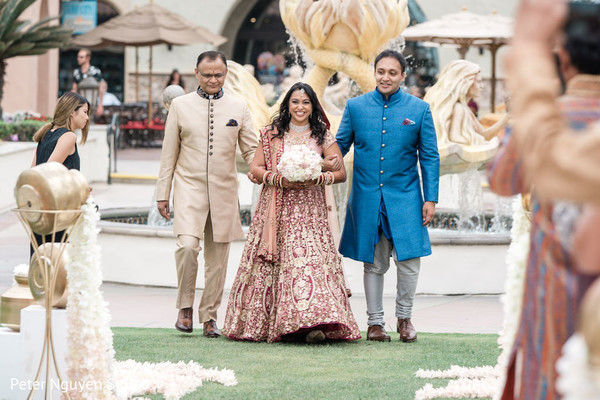 See this dazzling Indian bride escorted by her family