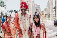Joyful Indian couple leaving the venue