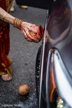 Indian wedding guest blessing the car