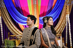 Indian bride and groom on their sangeet outfits.