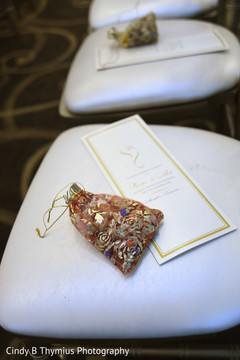 Closeup capture of Indian wedding ceremony favors and guide.