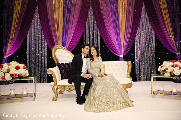 Lovely Indian couple at reception stage photo shoot.