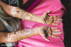 Closeup capture of maharani's mehndi art on her hands.