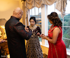 Indian bride getting ready for ceremony.