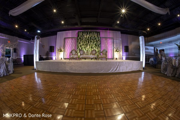 Stunning Indian wedding reception dance floor and stage capture.