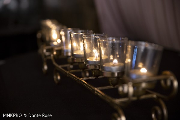 Elegant Indian wedding reception candle decor.