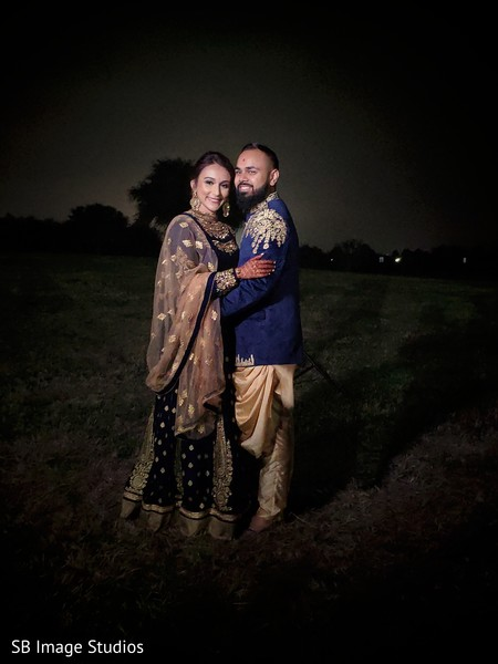 Indian wedding couple posing for pictures